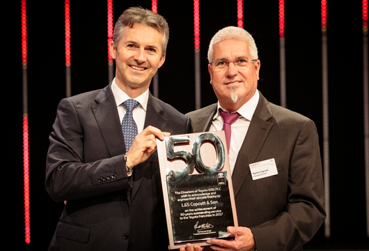 Paul Van der Burgh, President & Managing Director of Toyota (GB)PLC presents 50 year award to Martin Copcutt at Toyota National Conference.